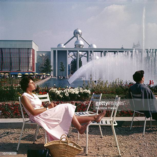 Sunbathing Before The French Flag And Atomium At The Exposition Universelle De Bruxelles On January 01St 1958