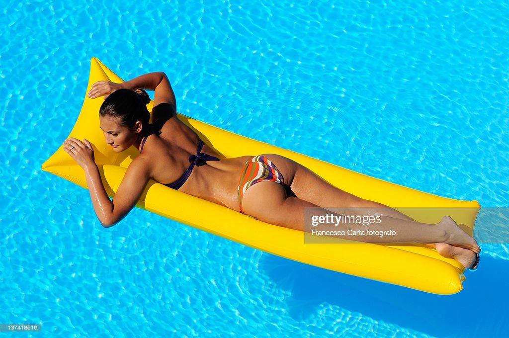 Sunbathing in the pool. : Stock Photo