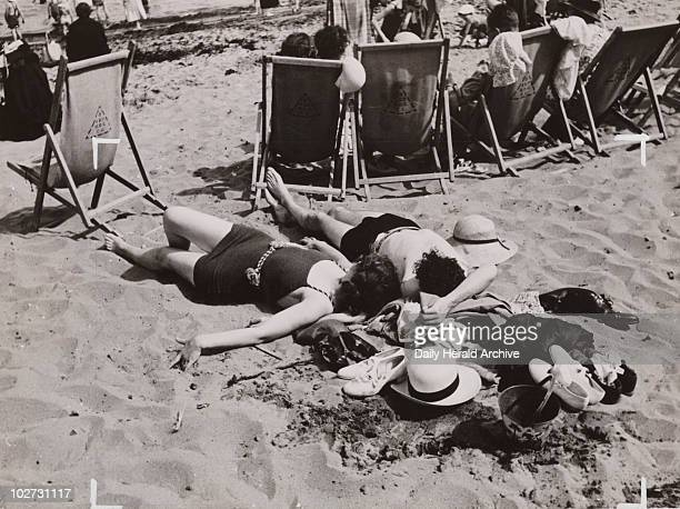 Sunbathing in the Sand 4 July 1936 A couple sunbath on the beach on a summer day in 1936