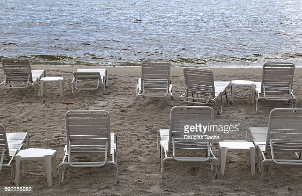 sunbathing lounge chairs on the beach, siesta beach, sarasota county, siesta key, florida, usa - siesta key stock photos and pictures