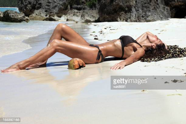 sunbathing - beautiful beach babes stock photos and pictures