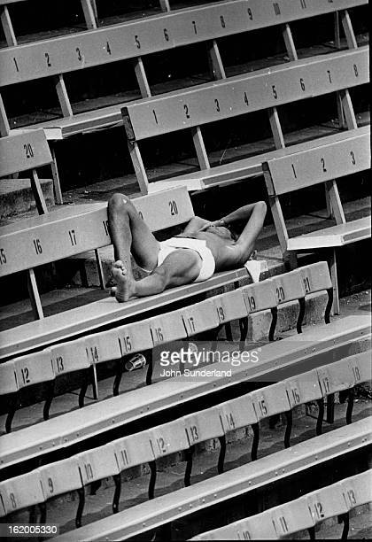 AUG 31 1974 SEP 1 1974 Sunbathing Wins Out Over Baseball at Mile High Stadium This fan apparently changed his mind about how to spend the afternoon...