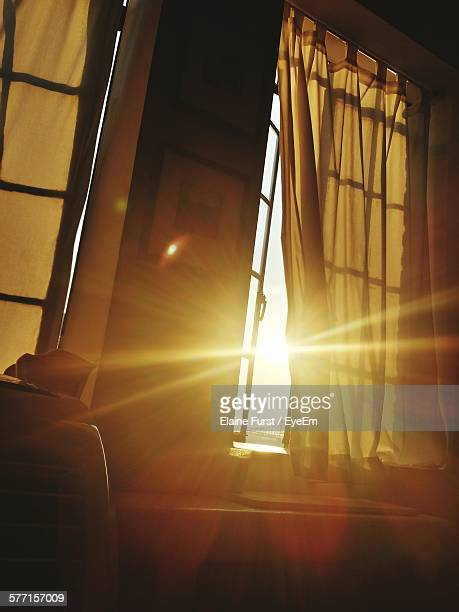 sunbeam emitting through open window at home - zonnestraal stockfoto's en -beelden