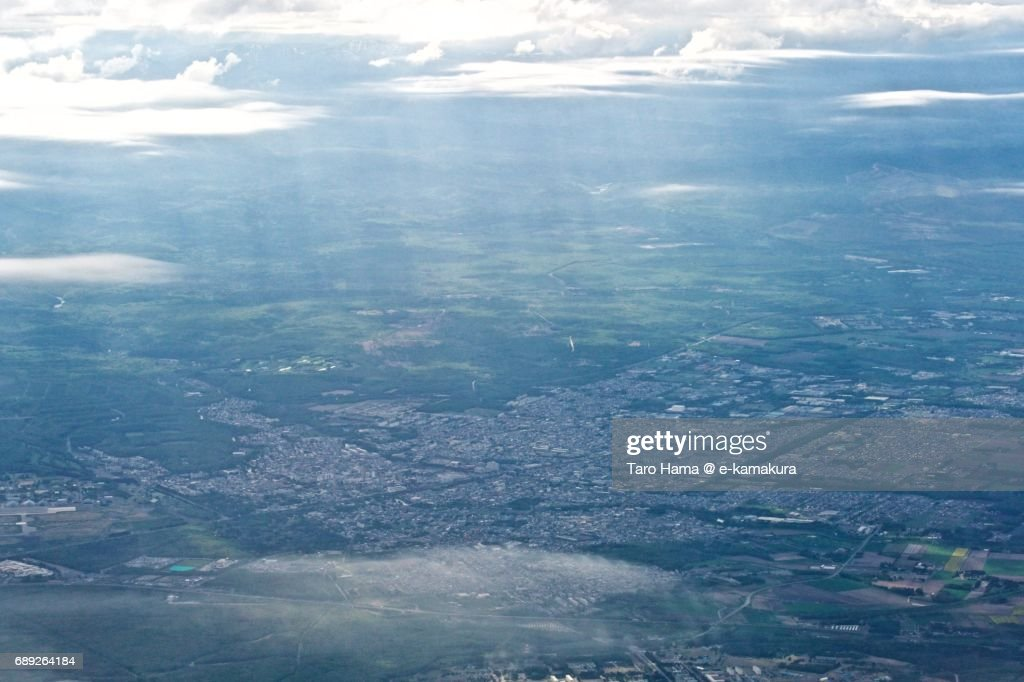 Sunbeam on Chitose city in Hokkaido daytime aerial view from airplane : Stock Photo