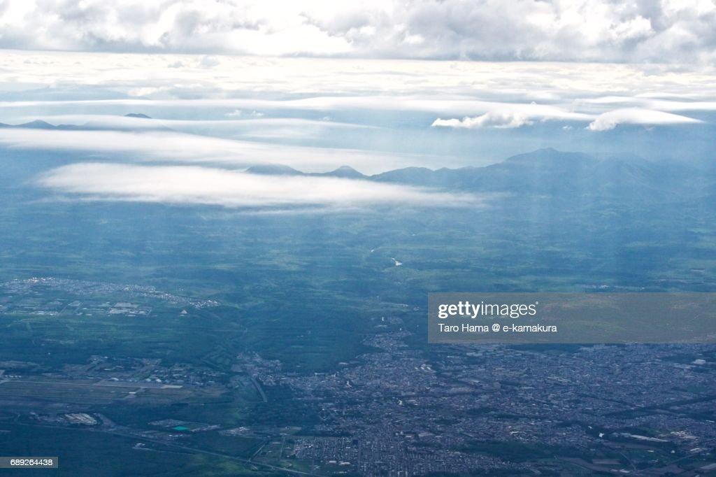 Sunbeam on Chitose city in Hokkaido daytime aerial view from airplane : Stock Photo