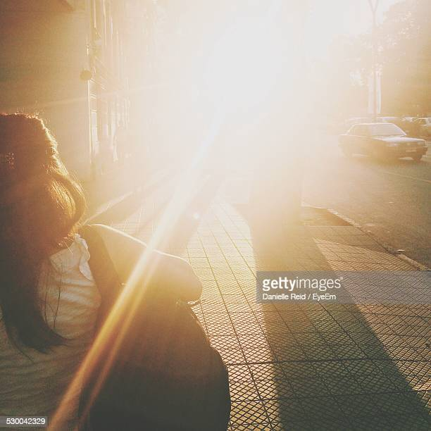 sunbeam on city street - danielle reid stock pictures, royalty-free photos & images