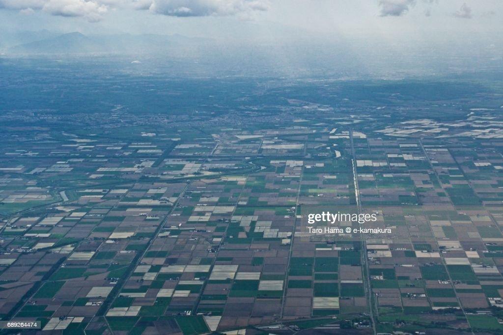 Sunbeam on Eniwa city in Hokkaido daytime aerial view from airplane : Stock Photo