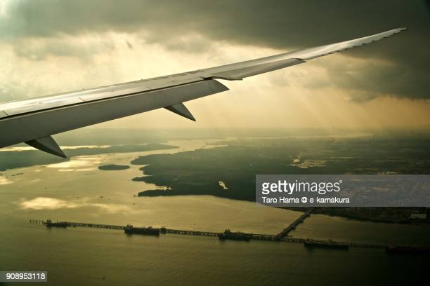 Sunbeam on Johor Strait in Malaysia day time aerial view from airplane