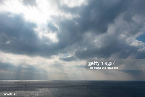 sunbeam on sagami bay, pacific ocean in hayama town and zushi and yokosuka cities in kanagawa prefecture in japan - overcast stock pictures, royalty-free photos & images