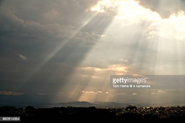 Sunbeam on the beach and town in Kamakura, Fujisawa and Chigasaki cities and Shonandgaira mountain in Hiratsuka city in Kanagawa prefecture in the sunset