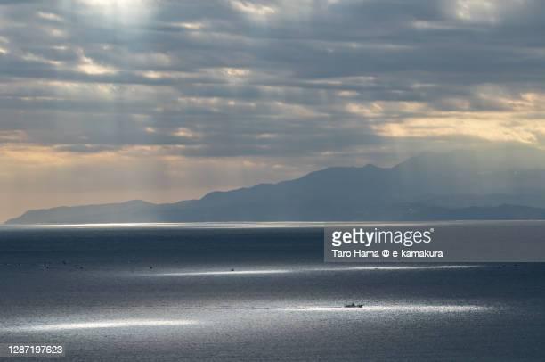 sunbeam on the morning beach in kanagawa prefecture of japan - taro hama ストックフォトと画像