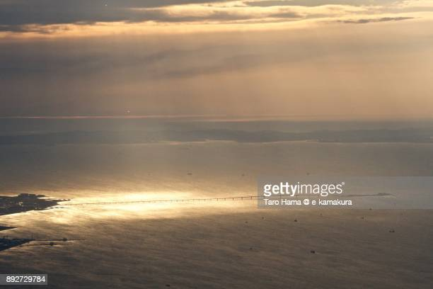 Sunbeam on Tokyo Bay Aqua Line in Japan sunset time aerial view from airplane