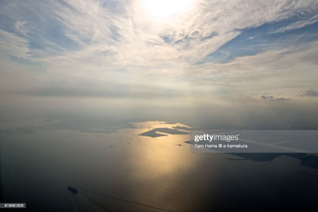 Sunbeam on Yokohama harbor in Kanagawa prefecture sunset time aerial view from airplane : ストックフォト