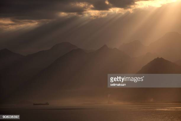 sunbeam over mediterranean sea in antalya, turkkey - le quattro stagioni foto e immagini stock