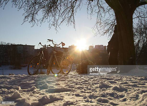 A sunbeam reflects as cyclists rest at Lietzenseepark on January 5 2009 in Berlin Germany Germany expects freezing conditions with snow ice and...