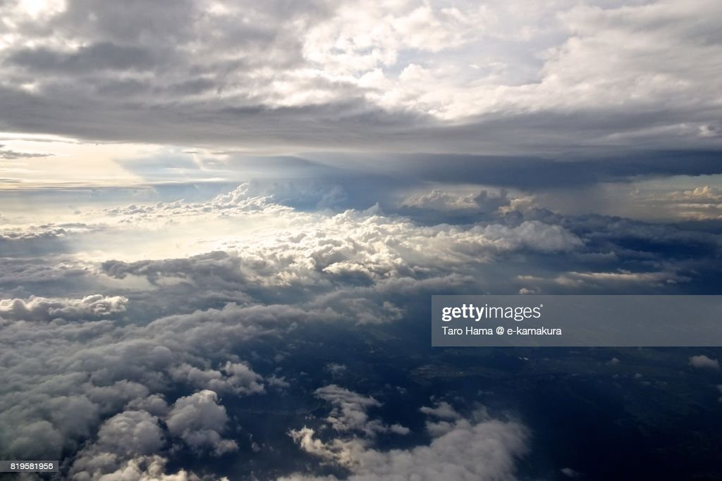 Sunbeam through clouds on Suzuka mountain range sunset time aerial view from airplane : ストックフォト