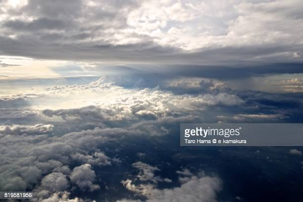 Sunbeam through clouds on Suzuka mountain range sunset time aerial view from airplane