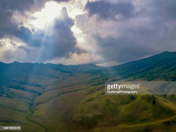 sunbeam through the clouds over bromo tengger semeru national park, east java - tengger stock pictures, royalty-free photos & images