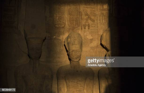 Sunbeams light up the statues of King Ramesses II at Abu Simbel temples in Aswan Egypt on February 22 2017 This occurrence happens twice per a year...