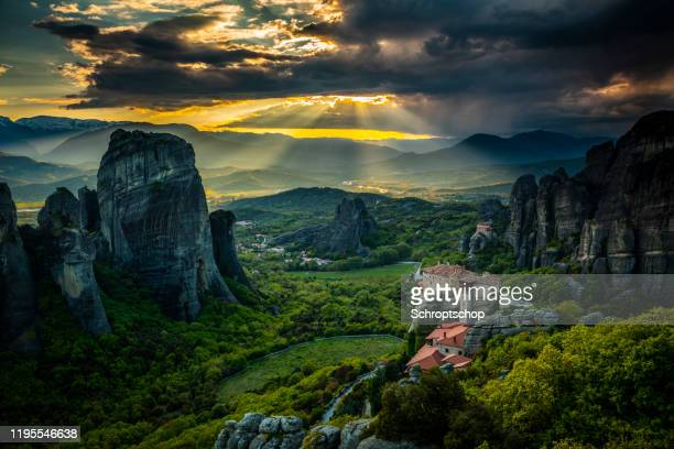 sunbeams over meteora in greece - thessaly stock pictures, royalty-free photos & images