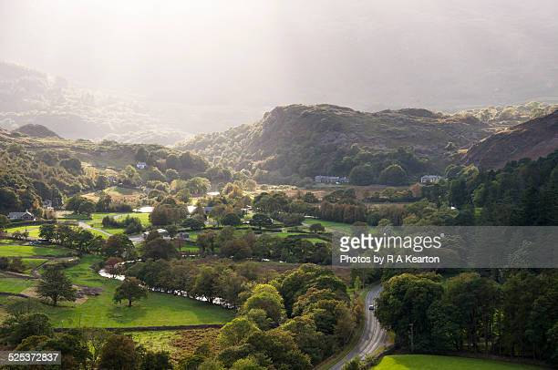 sunbeams over syngun, snowdonia - snowdonia stock photos and pictures