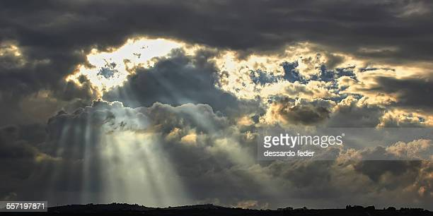 sunbeams - moody sky stock pictures, royalty-free photos & images