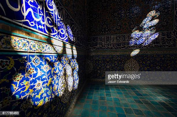 Sunbeams put spotlights on the tiled walls of the Sheikh Lotfollah Mosque.
