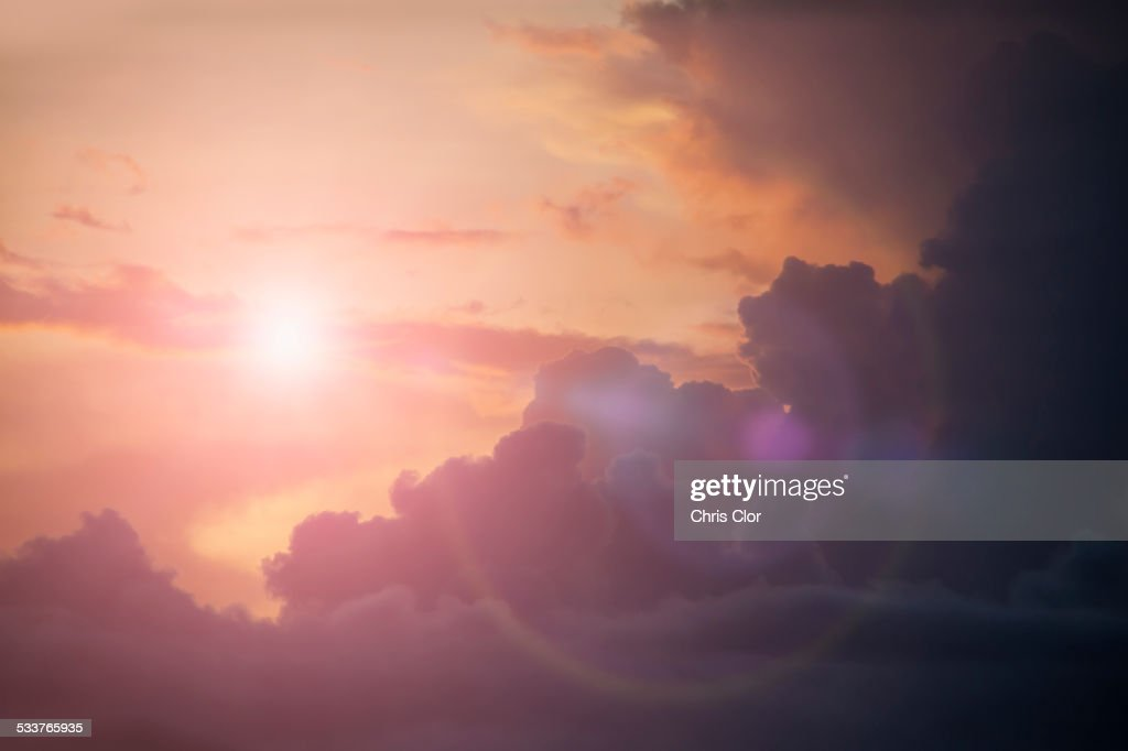 Sunbeams shining in cloudy sky : Foto stock