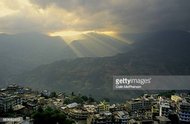 Sunbeams shining over the hills above the town of Gangtok Sikkim in northern India Sikkim was a landlocked state annexed by India in the Himalayas...