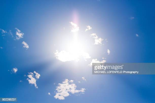 Sunbeams through the clouds in the blue sky