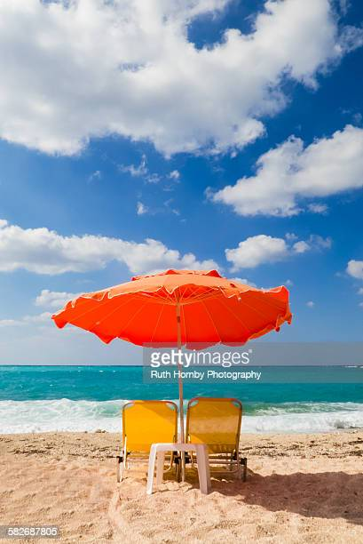 Sunbeds and parasol on a Greek beach.