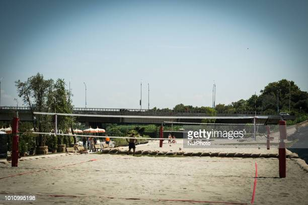 Sunbeds and parasols are prepared for visitors of the 'Tiberis' beach along the Tiber river on its opening day in Rome Italy 04 August 2018 The beach...