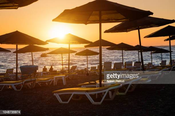 Sunbeds and umbrellas at sunset on the Mediterranean coast