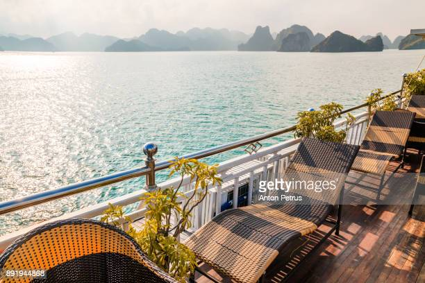 sunbeds on the open deck of a cruise ship. halong bay, vietnam - ponte di una nave foto e immagini stock
