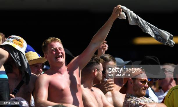 Sunburnt English cricket fans watch the action on the fourth day of the fifth Ashes cricket Test match between Australia and England at the SCG in...