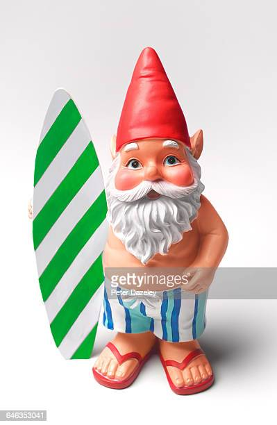 Sunburnt gnome with surfboard