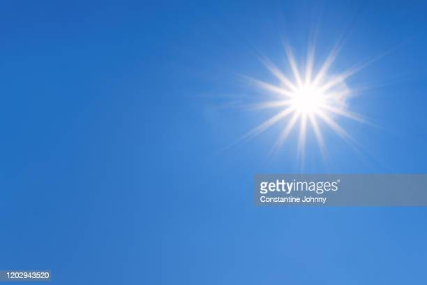 sunburst against clear blue sky - midday stock pictures, royalty-free photos & images