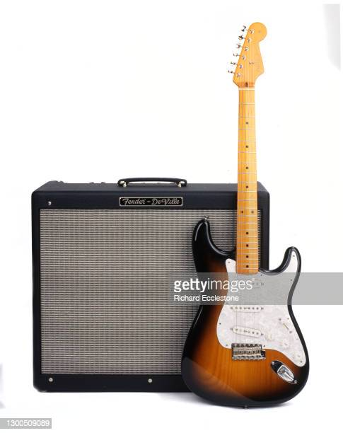 Sunburst Fender Stratocaster guitar and Fender De Ville amplifier, studio shot.