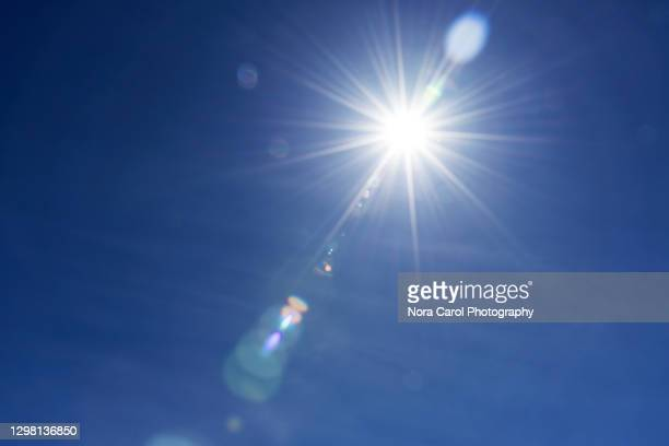 sunburst with lens flare - lens flare stock pictures, royalty-free photos & images