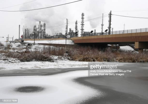 "Suncor Refinery, left, near Sand Creek February 10, 2021. ""n"