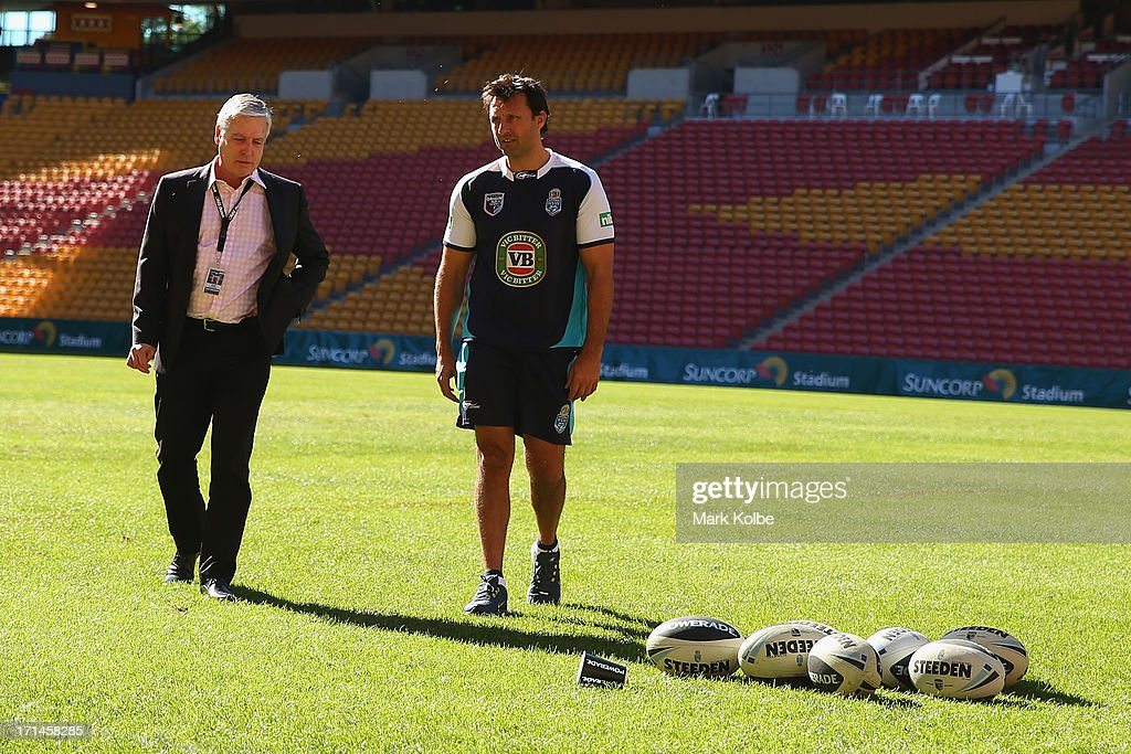 Suncorp stadium general manager Alan Graham speaks to Blues coach Laurie Daley on the field before a New South Wales Blues State of Origin training session at Suncorp Stadium on June 25, 2013 in Brisbane, Australia.