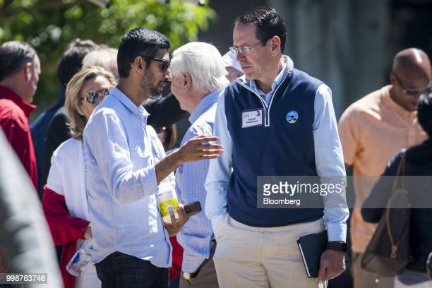 Sundar Pichai chief executive officer of Google Inc center left speaks with Randall Stephenson chairman and chief executive officer of ATT Inc center...