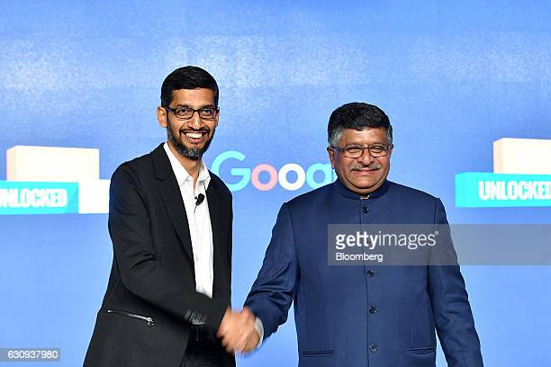 Sundar Pichai chief executive officer of Google Inc left shakes hands with Ravi Shankar Prasad India's minister for law and justice and information...