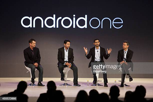 Sundar Pichai senior vice president of Android Chrome and Apps at Google Inc second right gestures as he speaks while Tom Oliveri vice president of...