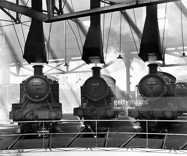 Sunday 28 July 1963 finds 8100 class 2-6-2T No.8109 and 5600 class 0-6-2T no�s 6609 and 5658 off duty in Tyseley Roundhouse, Birmingham.� Photograph...