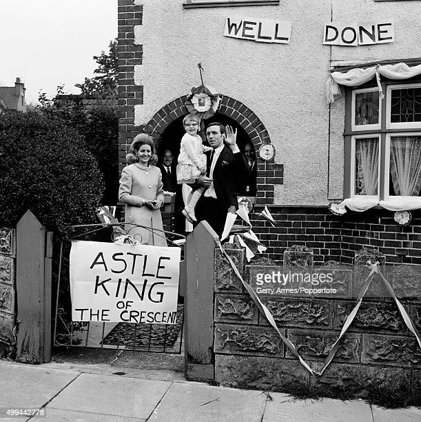 Sunday afternoon in the Crescent and neighbours have decorated the house of West Bromwich Albion striker Jeff Astle who has arrived home with his...