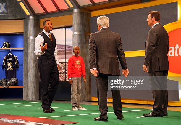 Sunday analyst Michael Strahan speaks to fellow analysts Jimmy Johnson and Howie Long as St Jude Children's Research Hospital patient Markell looks...