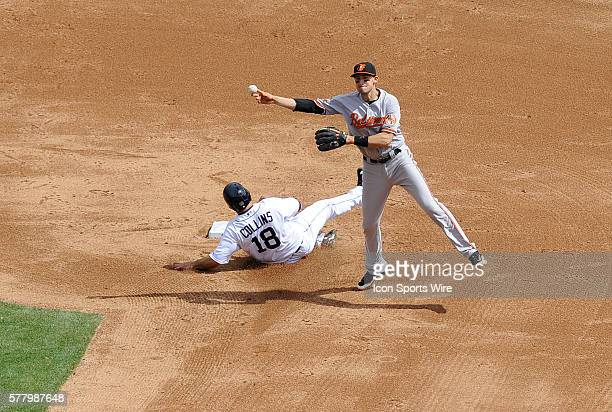 Baltimore Orioles shortstop Ryan Flaherty right tries to turn a double play in the sixth inning as Detroit Tiger baserunner Tyler Collins slides into...