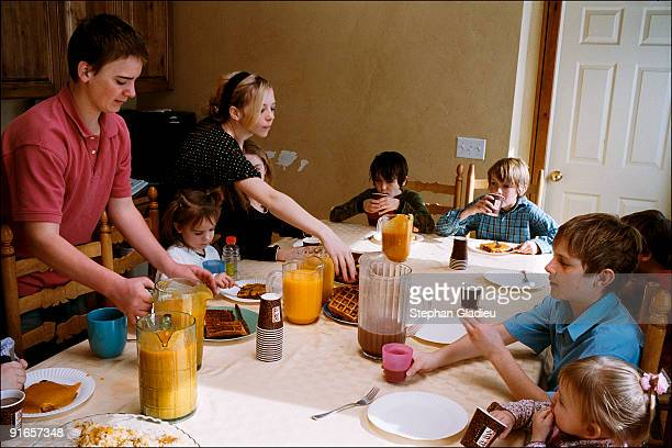 Sunday brunch in a polygamist family consisting of one husband , three wives , and 21 children. Sunday is one of the few days of the week when the...