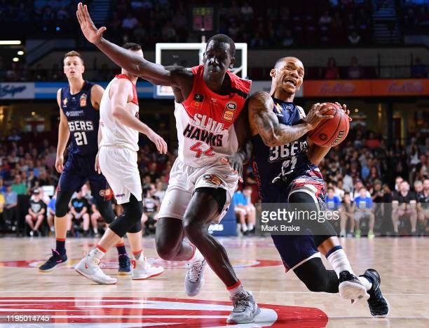 Sunday Dech of the Hawks competes with Jerome Randle of the 36ers during the round 12 NBL match between the Adelaide 36ers and the Illawarra Hawks at...